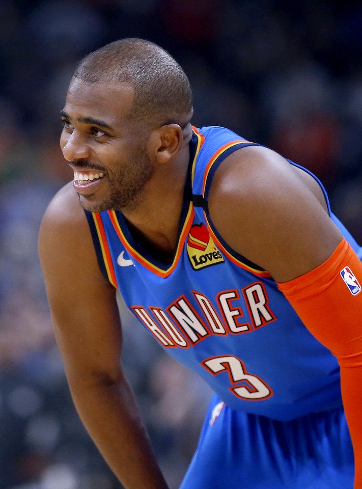 Photo - Oklahoma City's Chris Paul (3) laughs during the NBA basketball game between the Oklahoma City Thunder and the Atlanta Hawks at the Chesapeake Energy Arena in Oklahoma City,Friday, Jan. 24, 2020.  [Sarah Phipps/The Oklahoman]