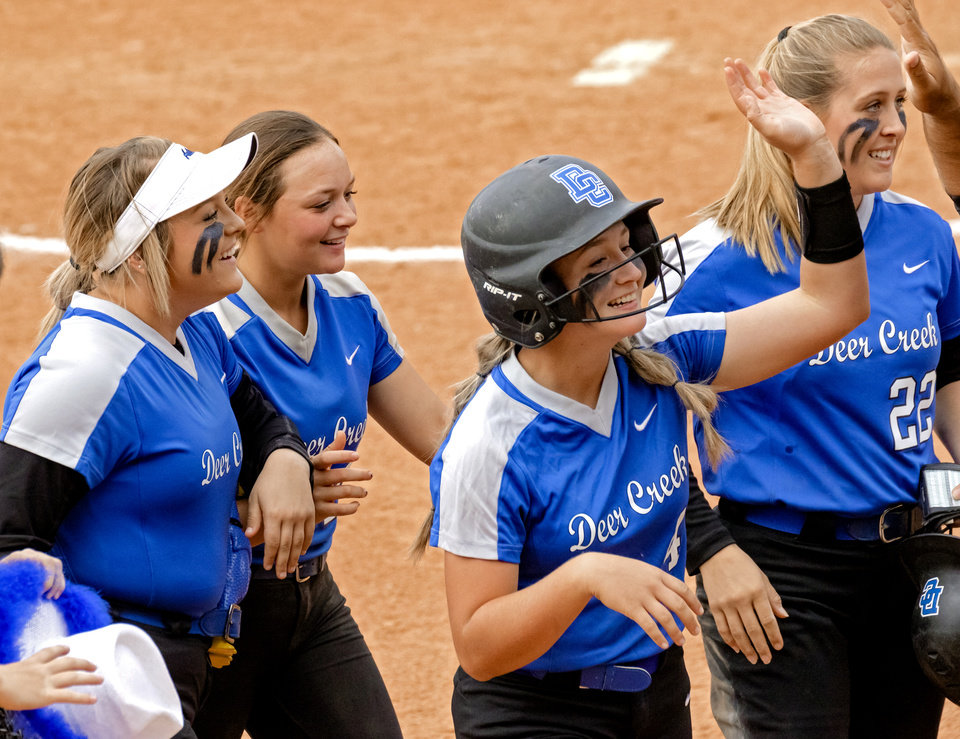 Photo - Deer Creek's Ashlee Hogg (4) celebrates with teammates after Hogg hit in the game winning run against Mustang during the high school state championship fast pitch softball quarterfinals at ASA Hall of Fame Stadium in Oklahoma City, Okla. on Thursday, Oct. 15, 2020. [Chris Landsberger/The Oklahoman]