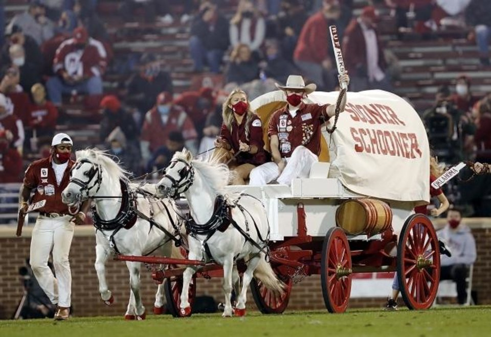 Photo -  OU senior Darby Dean became the first woman to drive the Sooner Schooner during a football game on Nov. 21 in Bedlam. Her second-quarter drive during the Bedlam game made history. [Ty Russell/SoonerSports.com]