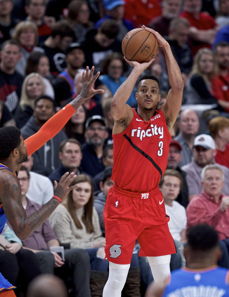 Photo - Portland Trail Blazers guard CJ McCollum shoots next to Oklahoma City Thunder forward Paul George, left, during the second half of an NBA basketball game in Portland, Ore., Friday, Jan. 4, 2019. (AP Photo/Craig Mitchelldyer)
