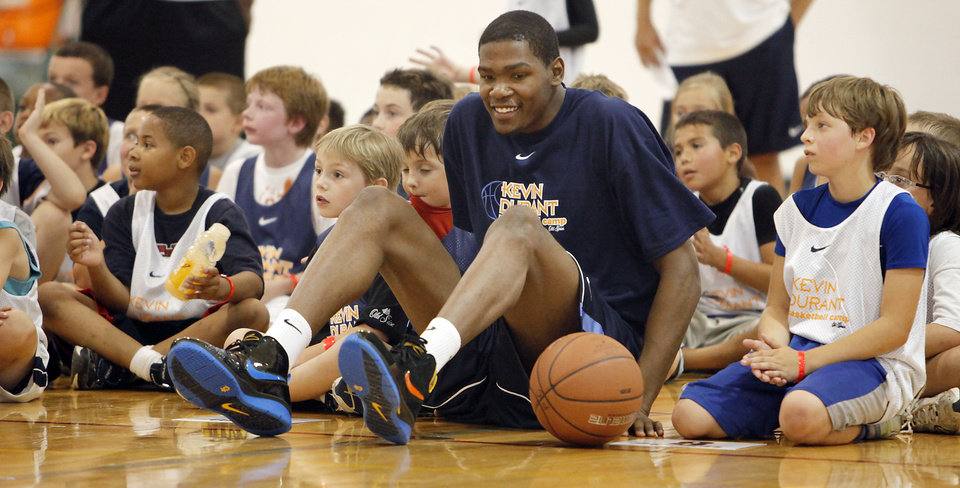 Photo - Kevin Durant, of the Oklahoma City Thunder, sits with the kids Durant's basketball camp at Heritage Hall on Tuesday, June 30, 2009, in Oklahoma City, Okla.  Photo by Chris Landsberger, The Oklahoman