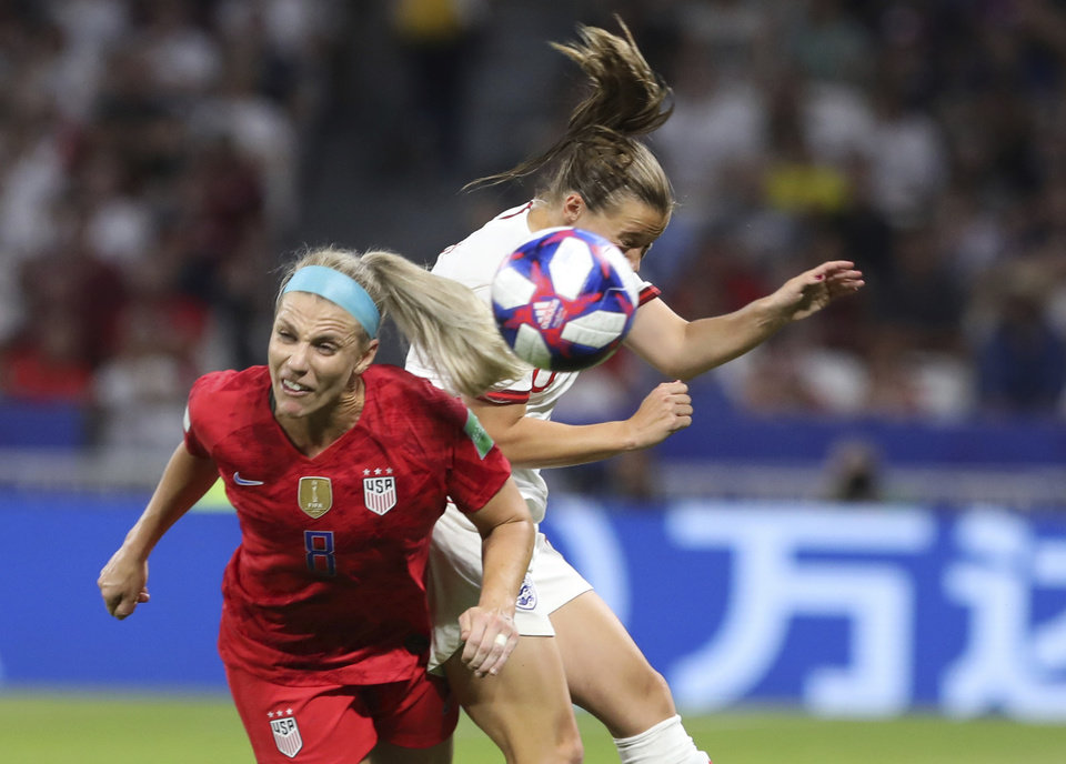 Photo - United States' Julie Ertz, left, and England's Fran Kirby challenge for the ball during the Women's World Cup semifinal soccer match between England and the United States, at the Stade de Lyon outside Lyon, France, Tuesday, July 2, 2019. (AP Photo/Laurent Cipriani)