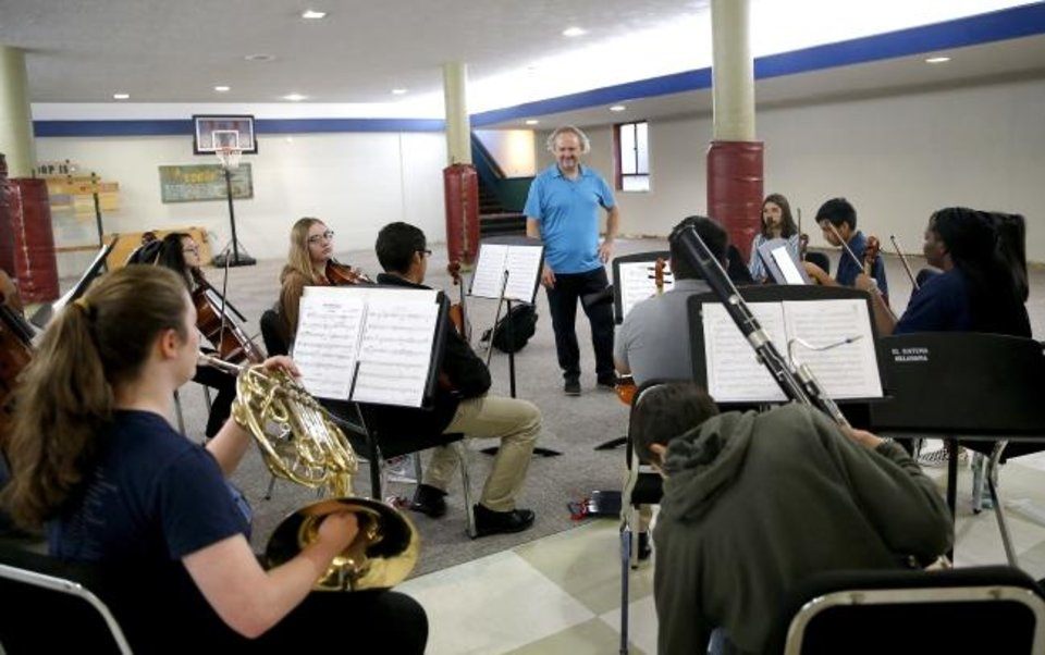 Photo -  Jeffrey Grogan directs a rehearsal of La Sala Musical, an ensemble with El Sistema Oklahoma,  on Sept. 19 at First Presbyterian Church of Oklahoma City. [Sarah Phipps/The Oklahoman]