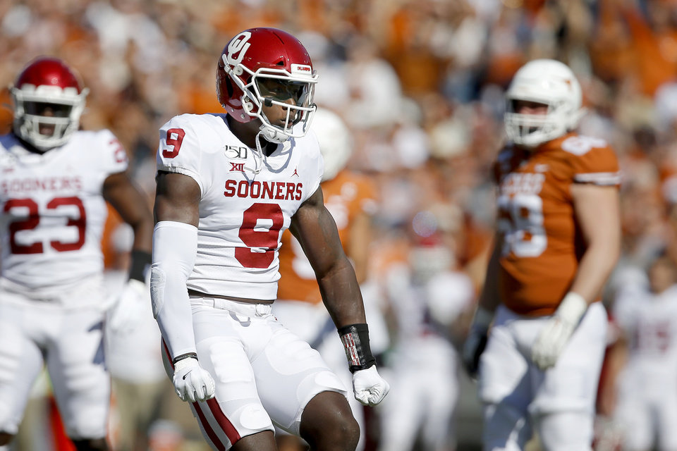 Photo - Oklahoma's Kenneth Murray (9) celebrates during the Red River Showdown college football game between the University of Oklahoma Sooners (OU) and the Texas Longhorns (UT) at Cotton Bowl Stadium in Dallas, Saturday, Oct. 12, 2019. Oklahoma won 34-27. [Bryan Terry/The Oklahoman]