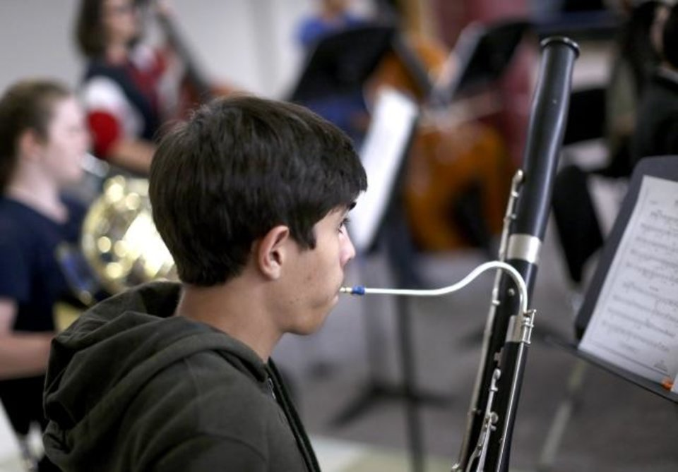 Photo -  Julian Guajardo plays the bassoon  on Sept. 19 during practice with El Sistema Oklahoma at First Presbyterian Church of Oklahoma City.  [Sarah Phipps/The Oklahoman]