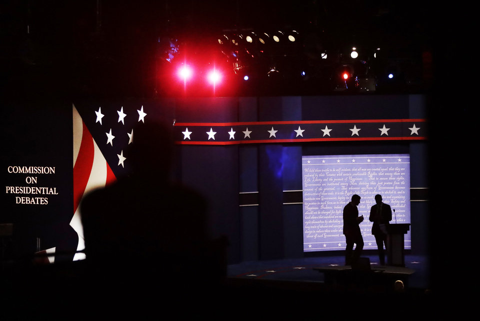 Photo - Workers prepare the stage for the presidential debate between Democratic presidential candidate Hillary Clinton and Republican presidential candidate Donald Trump at Hofstra University in Hempstead, N.Y., Monday, Sept. 26, 2016. (AP Photo/David Goldman)