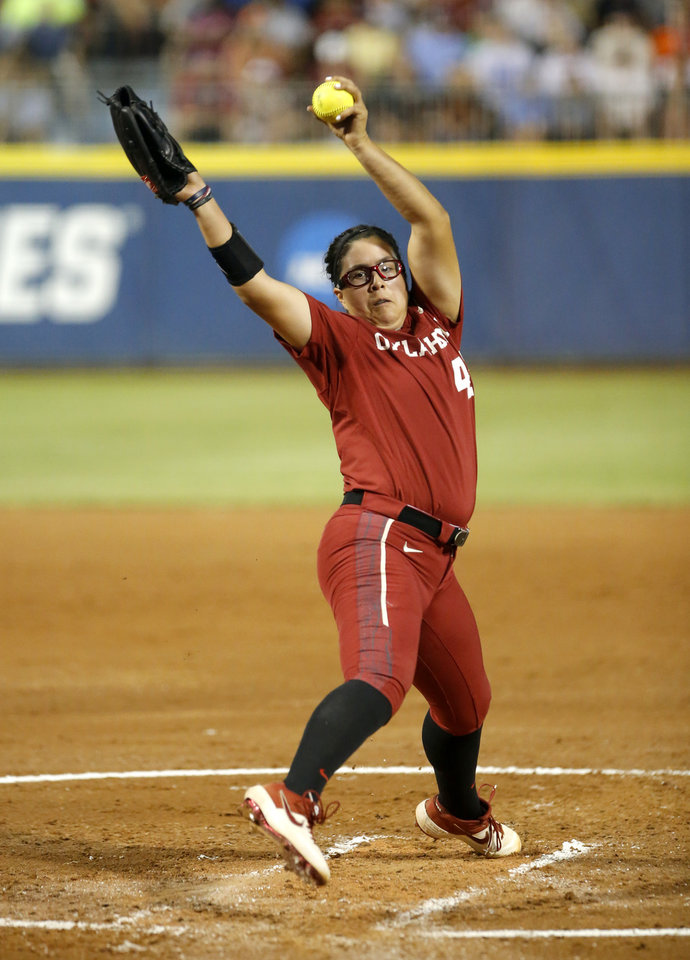 Photo - Oklahoma's Giselle Juarez (45) throws a pitch in the first inning during a Women's College World Series between Oklahoma State (OSU) and Oklahoma at USA Softball Hall of Fame Stadium in Oklahoma City,  Friday, May 31, 2019.  [Sarah Phipps/The Oklahoman]