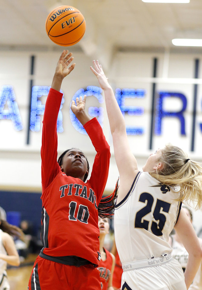 Photo - Carl Albert's Maylala Boyland shoots as Heritage Hall's Lucille Sullivan defends during the high school girls game between Heritage Hall and  Carl Albert at Heritage Hall in Oklahoma City, Friday, Jan. 17, 2020.  [Sarah Phipps/The Oklahoman]