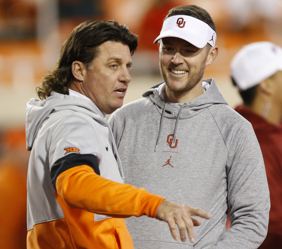 Photo - OSU head coach Mike Gundy, left, and OU head coach Lincoln Riley talk before the Bedlam college football game between the Oklahoma State Cowboys (OSU) and Oklahoma Sooners (OU) at Boone Pickens Stadium in Stillwater, Okla., Saturday, Nov. 30, 2019. [Nate Billings/The Oklahoman]