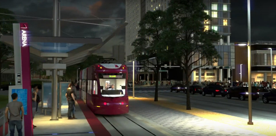 Photo -  The Oklahoma City Streetcar stop at Robinson Avenue and Oklahoma City Boulevard is shown with the Omni Hotel in the background. [Rendering by Skyline Ink]