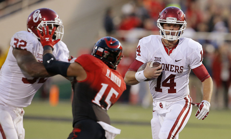 Photo -  Oklahoma's Cody Thomas (14) runs during a college football game between the University of Oklahoma Sooners (OU) and the Texas Tech Red Raiders at Jones AT&T Stadium in Lubbock, Texas, Saturday, November 15, 2014.  Photo by Bryan Terry, The Oklahoman