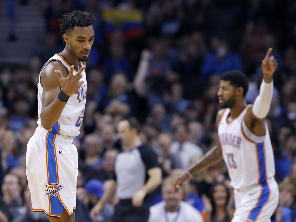 Photo - Oklahoma City's Terrance Ferguson (23) reacts after hitting a 3-point basket during the NBA game between the Oklahoma City Thunder and Minnesota Timberwolves at the Chesapeake Energy Arena, Tuesday, Jan. 8, 2019. Photo by Sarah Phipps, The Oklahoman
