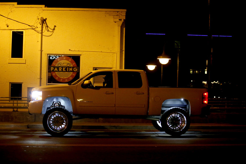 Photo - A truck drives through Bricktown in Oklahoma City, Friday, March 27, 2020. [Bryan Terry/The Oklahoman]