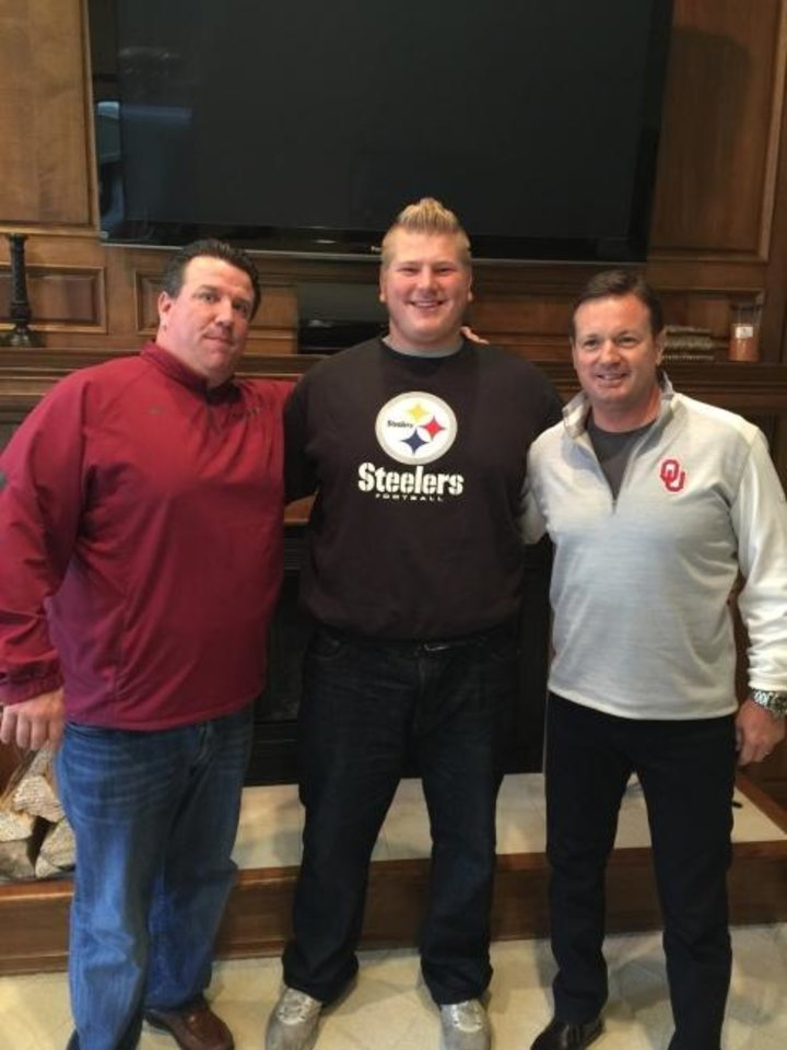 Photo -  When then-Oklahoma head coach Bob Stoops and offensive line coach Bill Bedenbaugh went on an in-home visit with Ben Powers, Powers wore a Steelers sweatshirt. A lifelone Steelers fan, Powers was drafted by the Baltimore Ravens. [PHOTO PROVIDED]