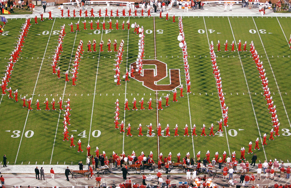 Photo - The Pride of Oklahoma marching band performs at Nov. 1 in Norman. The band is scheduled to leave Sunday for Miami, Fla. OKLAHOMAN ARCHIVE PHOTO  BY STEVE SISNEY