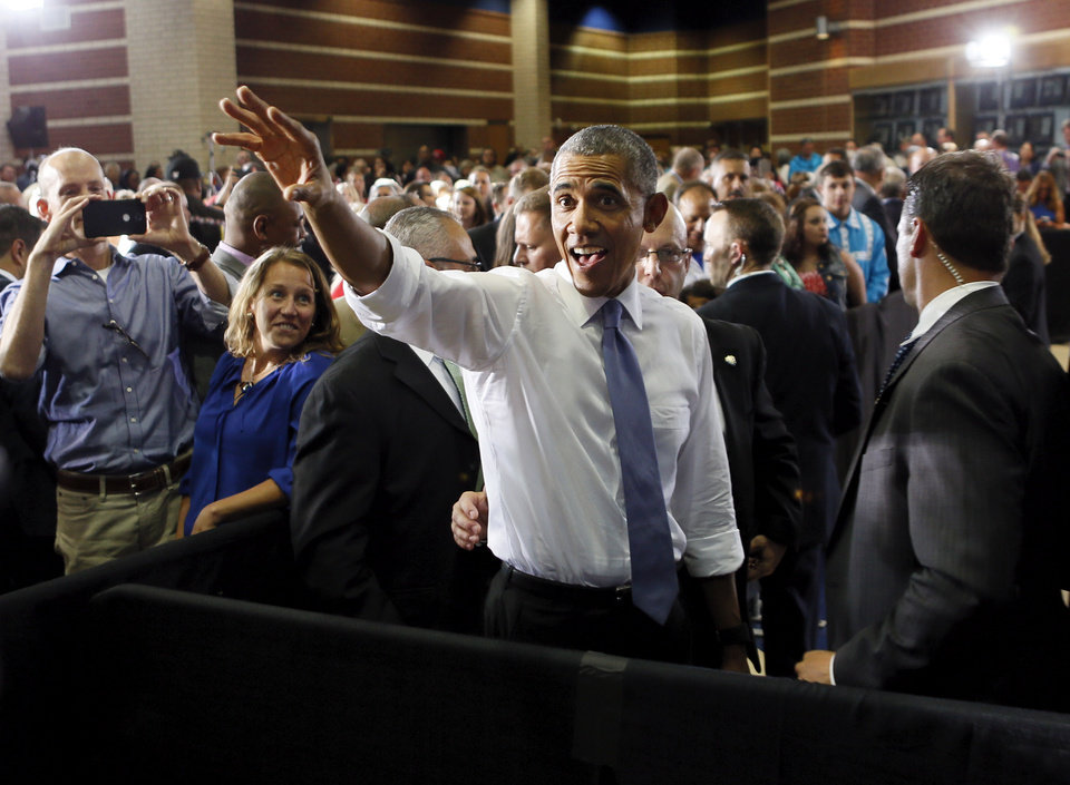 Photo - President Barack Obama waves to members of the audience after giving a speech at Durant High School in Durant, Okla., Wednesday, July 15, 2015. Photo by Nate Billings, The Oklahoman