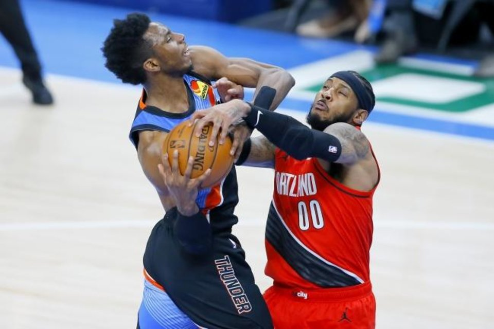 Photo -  Portland's Carmelo Anthony (00) tries to take the ball away from Oklahoma City's Hamidou Diallo (6) during the Blazers' win Tuesday. [Bryan Terry/The Oklahoman]