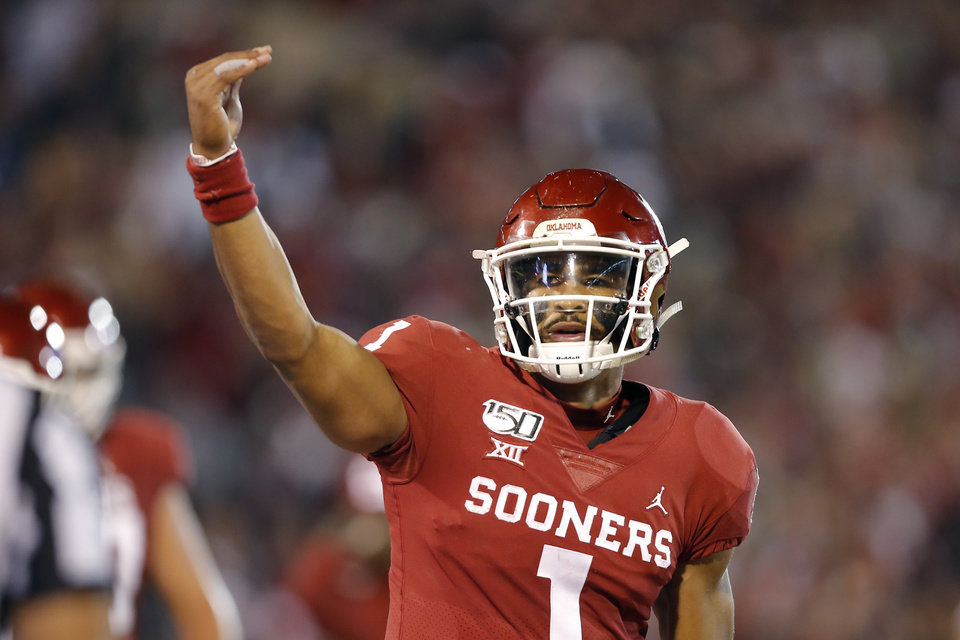 Photo - Oklahoma's Jalen Hurts (1) gestures after scoring a touchdown during an NCAA football game between the University of Oklahoma Sooners (OU) and the Iowa State University Cyclones at Gaylord Family-Oklahoma Memorial Stadium in Norman, Okla., Saturday, Nov. 9, 2019. [Bryan Terry/The Oklahoman]