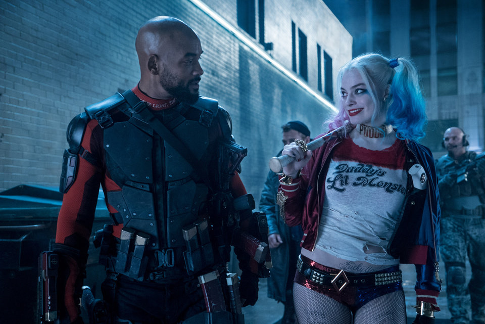 Photo -  Will Smith as Deadshot and Margot Robbie as Harley Quinn in Warner Bros. Pictures' action adventure