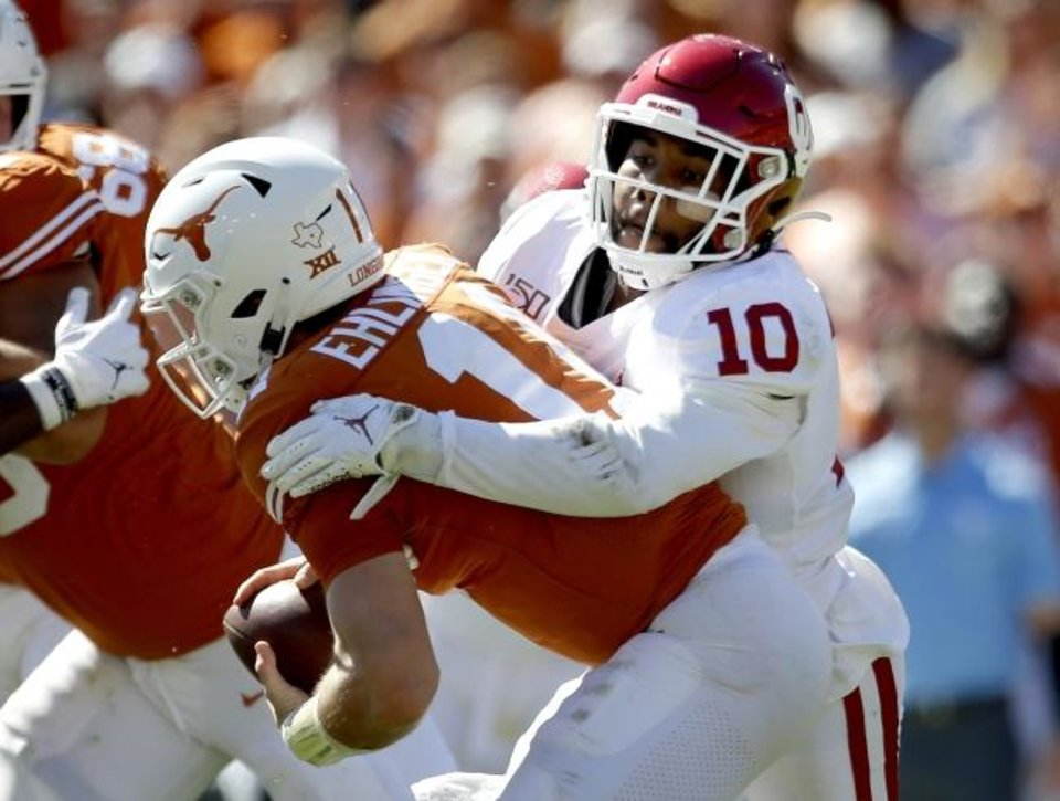 Photo -  Oklahoma's Pat Fields (10) sacks Texas quarterback Sam Ehlinger (11) during the Red River Showdown in October. [Sarah Phipps/The Oklahoman Archives]