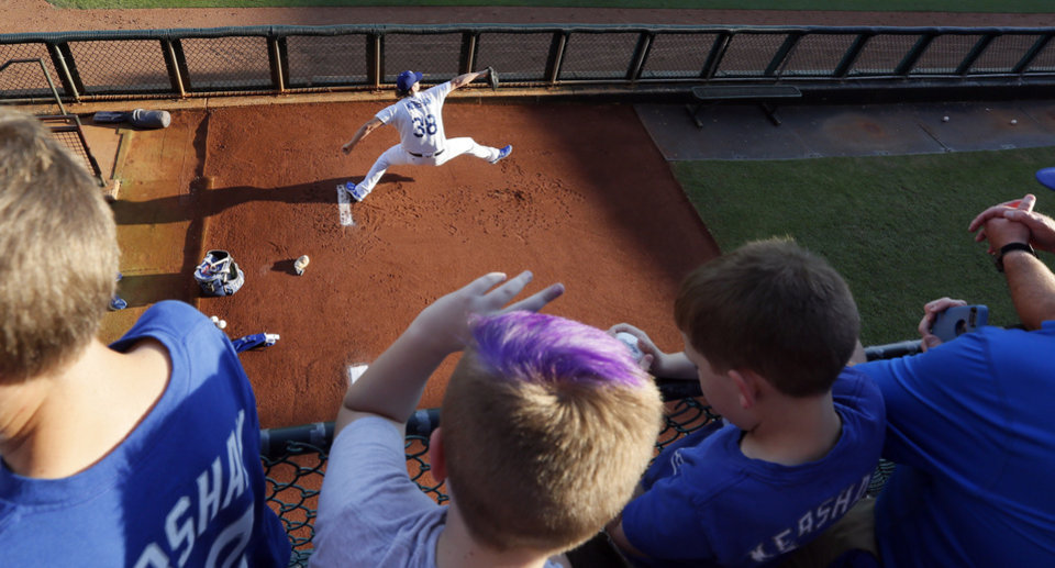 Photo - Fans watch Los Angeles pitcher Clayton Kershaw warm up in the bullpen before pitching a rehab assignment in a Triple-A baseball game between the Oklahoma City Dodgers and the Omaha Storm Chasers at the Chickasaw Bricktown Ballpark in Oklahoma City, Saturday, Aug. 26, 2017. Photo by Nate Billings, The Oklahoman