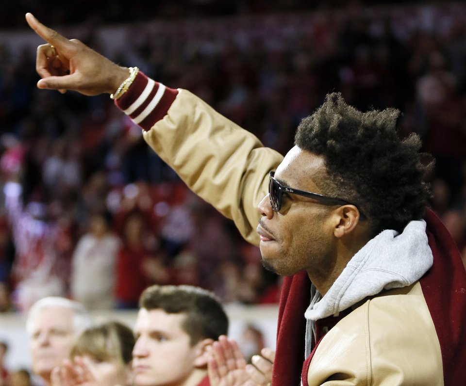 Photo - Buddy Hield, Sacramento Kings guard and former OU player, points as he is acknowledged by fans during a men's college basketball game between the Oklahoma Sooners and the Texas Longhorns at the Lloyd Noble Center in Norman, Okla., Saturday, Feb. 23, 2019. Oklahoma won 69-67. Photo by Nate Billings, The Oklahoman
