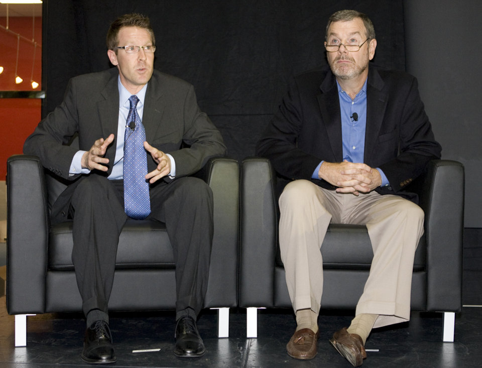 Photo - Team general manager Sam Presti, left, talks as head coach PJ Carlesimo listens during the unveiling of the Oklahoma City Thunder NBA team name at Leadership Square in downtown Oklahoma City, Wednesday, September 3, 2008. NATE BILLINGS, THE OKLAHOMAN