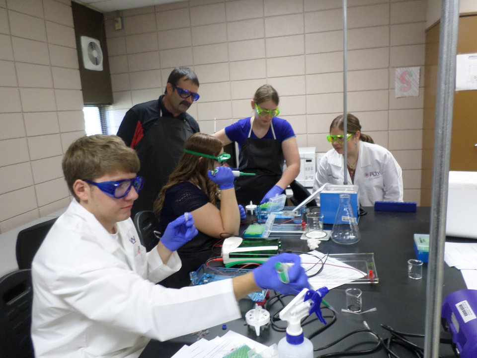 Photo - These BioMed 2 students on NWTC's Fairview campus are performing a genetic transfer lab using Gel Electrophoresis.   They are removing a gene from a jellyfish.  Pictured are (l to r) Brockton Keen, Lacey Belvin, Shawn Cusack, Shasta Hess and Breanna Nightengale.  (Photo by Shawn Cusack)