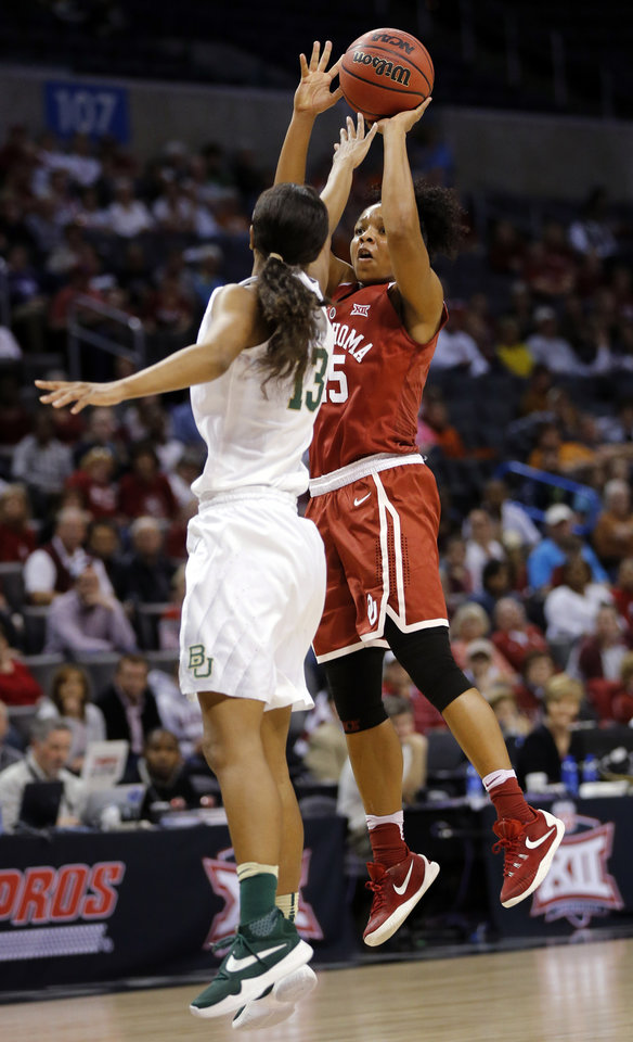 Photo - Oklahoma's Gioya Carter (25) shoots against Baylor's Nina Davis (13) during a semifinal game in the Big 12 Women's Basketball Championship between the Oklahoma Sooners (OU) and the Baylor Lady Bears at Chesapeake Energy Arena in Oklahoma City, Sunday, March 6, 2016. Photo by Nate Billings, The Oklahoman