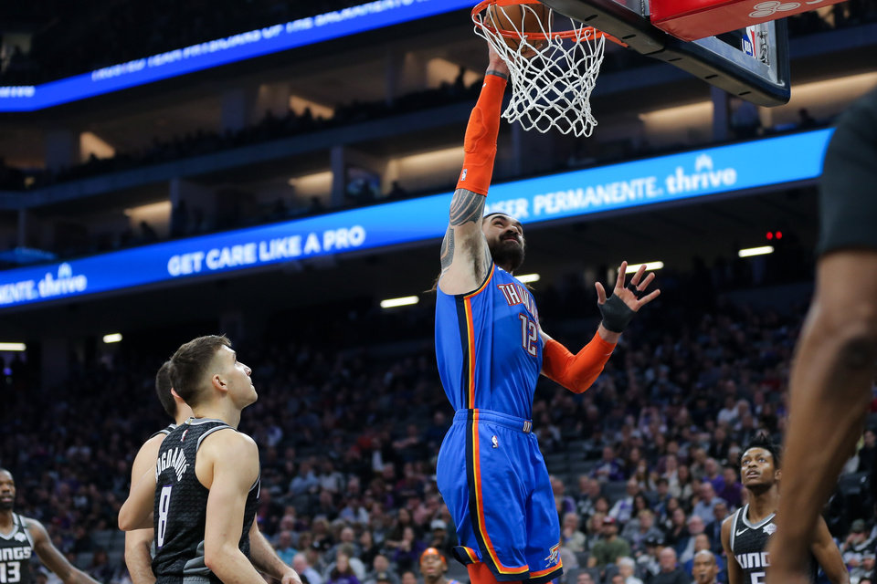 Photo - Jan 29, 2020; Sacramento, California, USA; Oklahoma City Thunder center Steven Adams (12) dunks the ball during the first quarter against the Sacramento Kings at Golden 1 Center. Mandatory Credit: Sergio Estrada-USA TODAY Sports