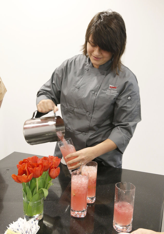 Photo -  Right: Chef Erin Buono pours a new Splash drink at Sonic Drive In's new test kitchen at its Bricktown headquarters.  Photos by Paul Hellstern, The Oklahoman   PAUL HELLSTERN -  Oklahoman