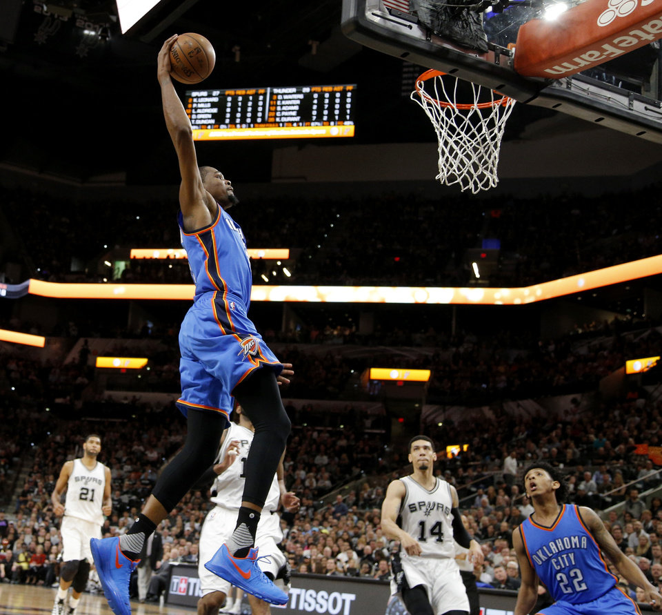 Photo - Oklahoma City's Kevin Durant (35) dunks the ball during Game 2 of the second-round series between the Oklahoma City Thunder and the San Antonio Spurs in the NBA playoffs at the AT&T Center in San Antonio, Monday, May 2, 2016. Photo by Bryan Terry, The Oklahoman