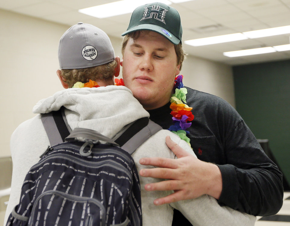 Photo - J.R. Hensley, right, hugs older brother Ty Hensley at the end of a national signing day ceremony at Edmond Santa Fe High School in Edmond, Okla., Wednesday, Feb. 4, 2015. J.R. Hensley signed to play football at the University of Hawaii. Ty Hensley also went to Edmond Santa Fe and is a Yankees prospect. Photo by Nate Billings, The Oklahoman