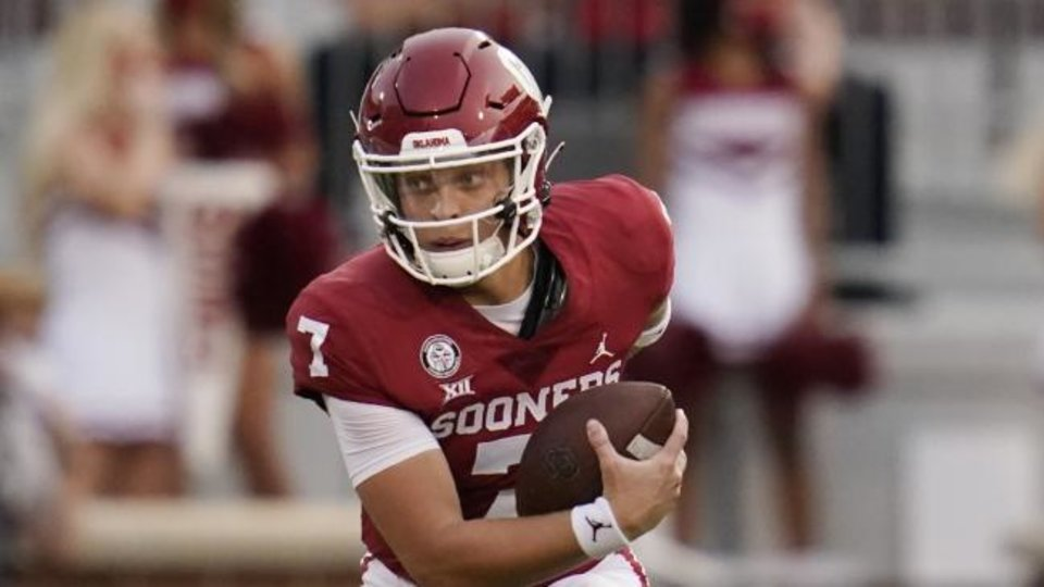 Photo -  OU quarterback Spencer Rattler had four carries for one yard with a long run of 10 yards in the season opener. [AP Photo/Sue Ogrocki]