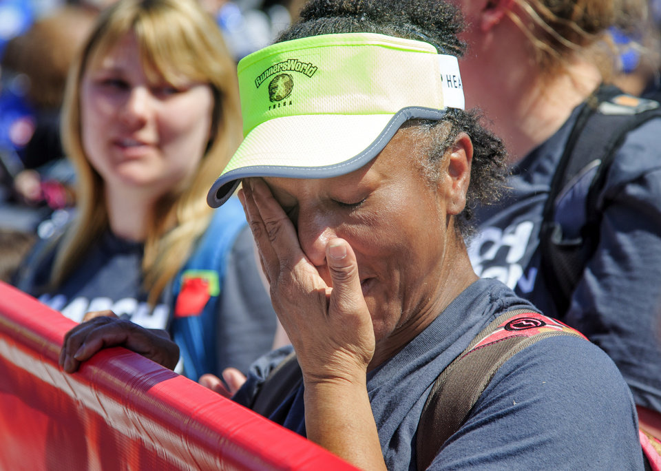 Photo - Tulsa Public School's Sharon Raines wipes tears from her eyes as she arrives at the Capitol after taking part in a 110 mile walk from Tulsa during the ninth day of a walkout by Oklahoma teachers at the state Capitol in Oklahoma City, Okla. on Tuesday, April 10, 2018.   Photo by Chris Landsberger, The Oklahoman