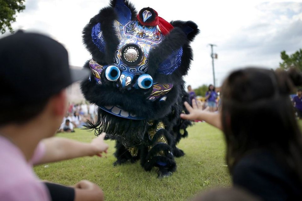 Photo - Lion dancers entertain crowds during a lion dance competition at the 2019 Asian Night Market Festival at Military Park in Oklahoma City, Saturday, June 15, 2019. [Sarah Phipps/The Oklahoman Archives]