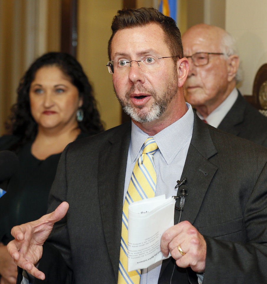 Photo - Kris Steele, executive director of Oklahomans for Criminal Justice Reform, speaks outside the Oklahoma Secretary of State's office after Oklahomans for Sentencing Reform filed a constitutional ballot initiative at the state Capitol in Oklahoma City, Tuesday, Nov. 12, 2019. The initiative would end some sentence enhancements for nonviolent offenses and allow people who are currently serving those sentences to petition for relief. [Nate Billings/The Oklahoman]