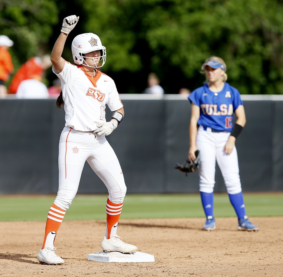 Photo - Oklahoma State's Madi Sue Montgomery (10) celebrates after driving in a run on a double in the third inning of the Stillwater Regional NCAA softball tournament game between Oklahoma State University (OSU) and Tulsa in Stillwater, Okla., Saturday, May 18, 2019. Oklahoma State won 2-1. [Bryan Terry/The Oklahoman]