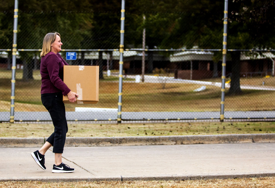 Photo - Tara Morris carries her box of personal belongings to the car after being released from the Dr. Eddie Warrior Correctional Facility on Monday, Nov. 4, 2019 in Taft, Okla. Governor Kevin Stitt greeted an estimated 70 women whose sentences he commuted from the facility. [Chris Landsberger/The Oklahoman]