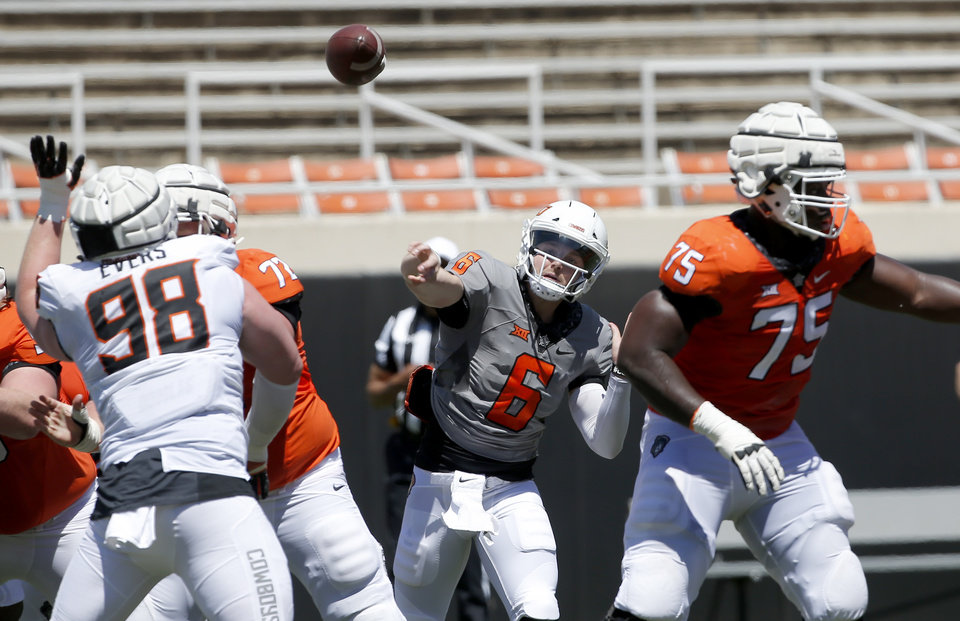 Photo - Oklahoma State's Dru Brown (6) throws the ball during the Oklahoma State Cowboys spring practice at Boone Pickens Stadium in Stillwater, Okla., Saturday, April 20, 2019.  Photo by Sarah Phipps, The Oklahoman