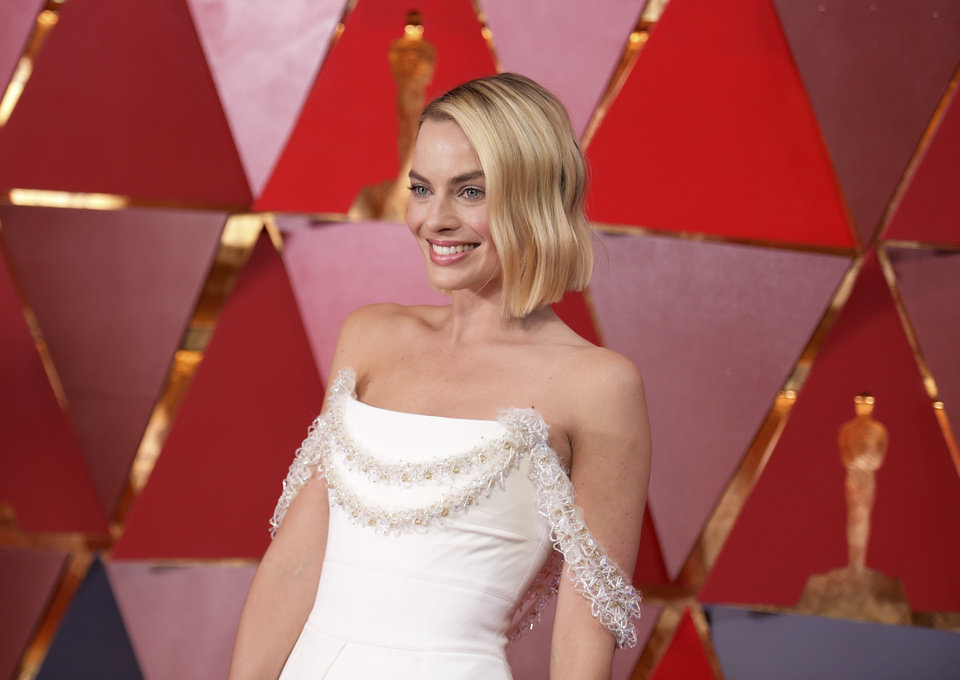Photo - Margot Robbie arrives at the Oscars on Sunday, March 4, 2018, at the Dolby Theatre in Los Angeles. (Photo by Richard Shotwell/Invision/AP)