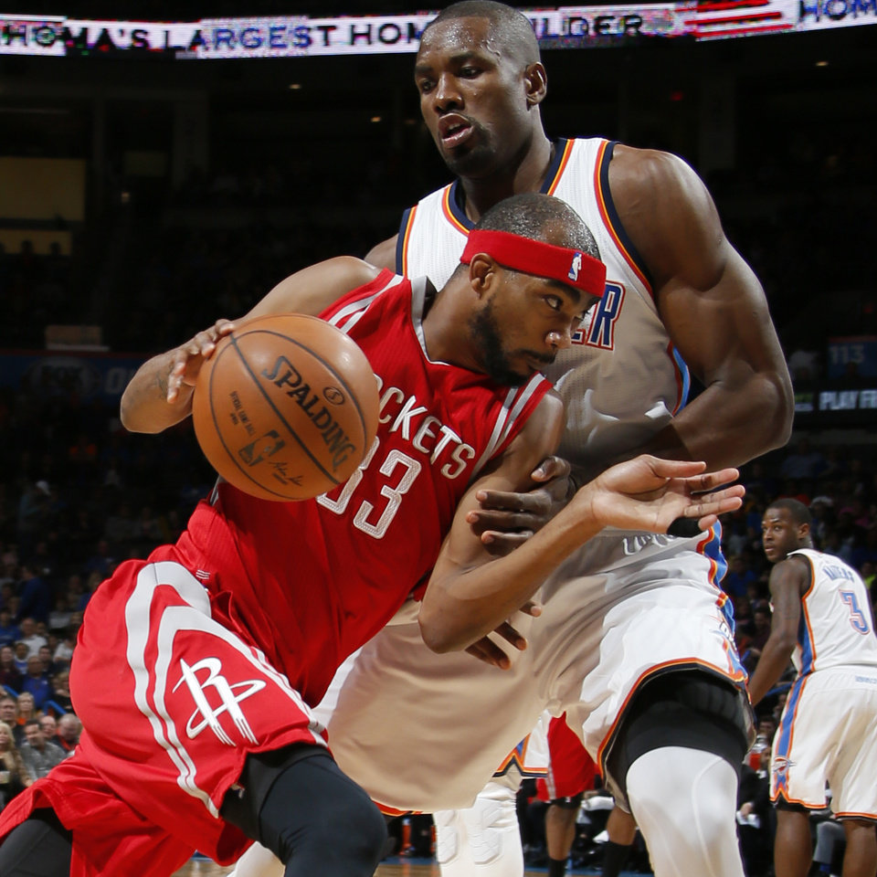Photo - Oklahoma City's Serge Ibaka (9) defends Houston's Corey Brewer (33) during an NBA basketball game between the Oklahoma City Thunder and the Houston Rockets at Chesapeake Energy Arena in Oklahoma City, Friday, Jan. 29, 2016. Oklahoma City won 116-108. Photo by Bryan Terry, The Oklahoman