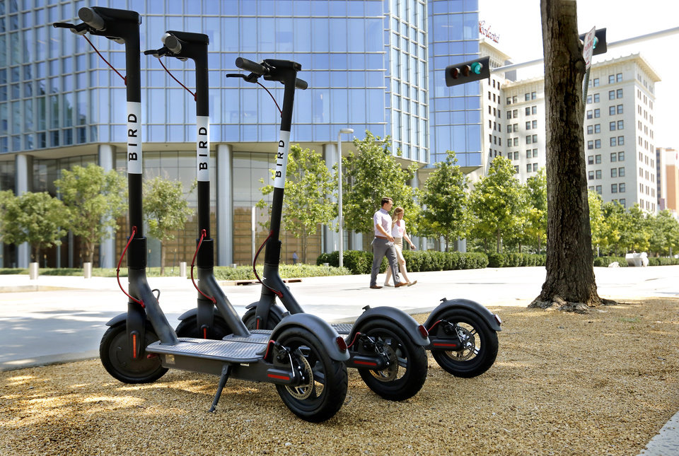 Photo -  Bird motorized scooters are parked near the Myriad Botanical Gardens on W Sheridan Avenue in front of the Devon Tower on Thursday. The company said it kicked off a pilot program in Oklahoma City to test its fleet of dock-free, low-speed, electric scooters with members of the community. [PHOTOS BY JIM BECKEL, THE OKLAHOMAN]