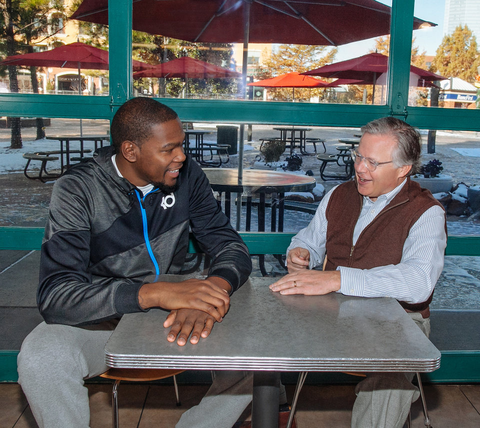 Photo -  Sonic Corp. spokesman and Thunder star Kevin Durant at a restaurant with Sonic CEO Cliff Hudson.