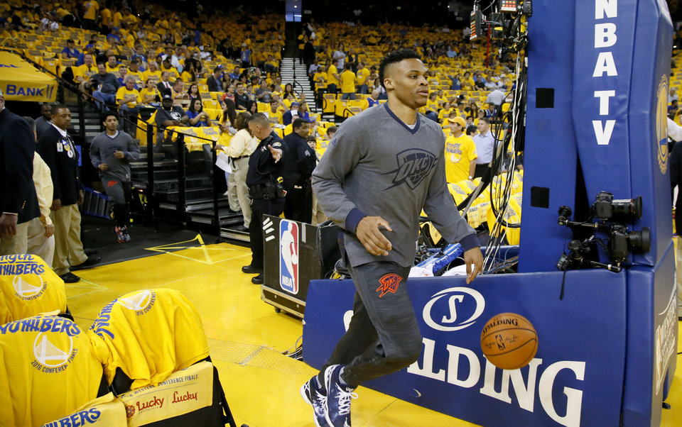 Photo - Oklahoma City's Russell Westbrook (0) takes the court before Game 2 of the Western Conference finals in the NBA playoffs between the Oklahoma City Thunder and the Golden State Warriors at Oracle Arena in Oakland, Calif., Wednesday, May 18, 2016. Photo by Nate Billings, The Oklahoman