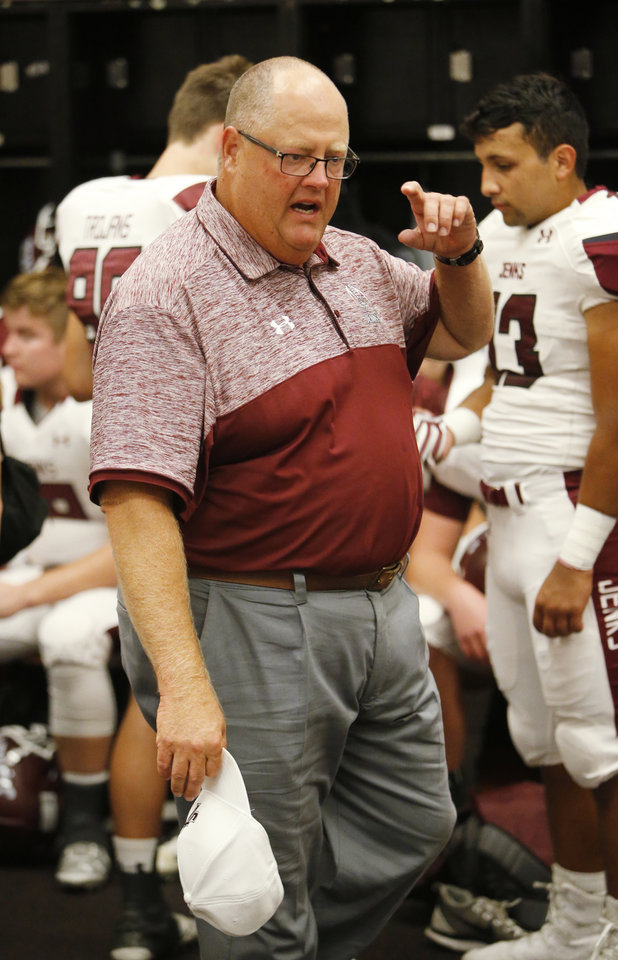 Photo - Jenks head coach Allan Trimble prepares his Jenks Trojans to play the Norman High School Tigers on Friday, Sept. 23, 2016 in Norman, Okla. Photo by Steve Sisney, The Oklahoman