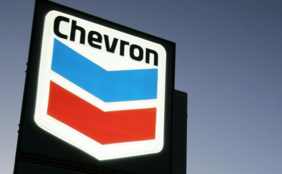 Photo - FILE - In this file photograph taken July 25, 2007, a Chevron gas station service sign is displayed in Menlo Park, Calif.  Chevron is buying Anadarko Petroleum in a cash-and-stock deal valued at $33 billion that'll help strengthen its position in shale, deepwater and natural gas resource basins.  Chevron and Anadarko said Friday, April 12, 2019 that the deal will create a 75-mile-wide corridor across the most attractive acreage in the Delaware basin; bolster Chevron's position in the Gulf of Mexico and add a resource base in Mozambique to support growing LNG demand. (AP Photo/Paul Sakuma, file)