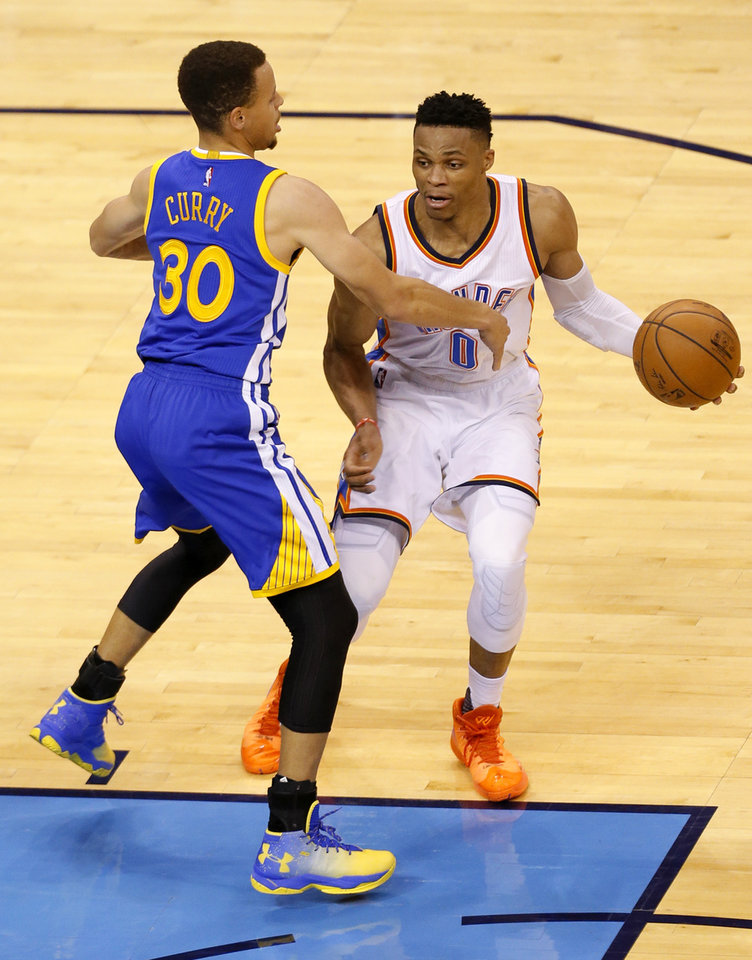 Photo - Oklahoma City's Russell Westbrook (0) looks to get around Golden State 's Stephen Curry (30) during Game 3 of the Western Conference finals in the NBA playoffs between the Oklahoma City Thunder and the Golden State Warriors at Chesapeake Energy Arena in Oklahoma City, Sunday, May 22, 2016. Photo by Sarah Phipps, The Oklahoman