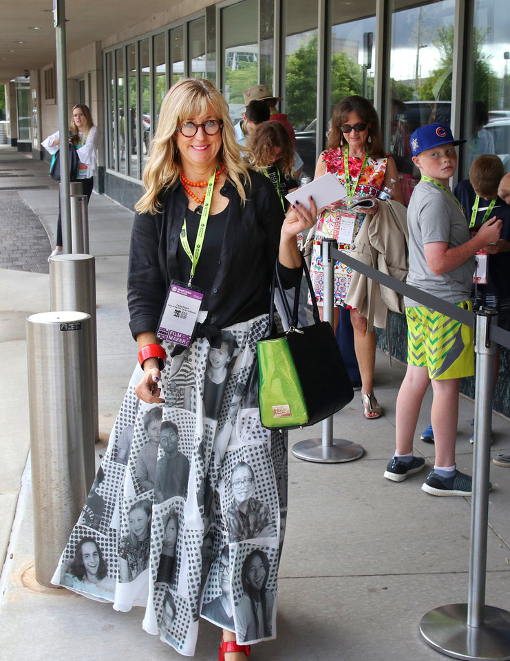"Photo - ""Faces of the 47th"" filmmaker Cacky Poarch hands out promo cards for her film to people in line at OKCMOA. Opening night for deadCenter at the Oklahoma City Museum of Art, Thursday, June 6, 2019. [Doug Hoke/The Oklahoman]"