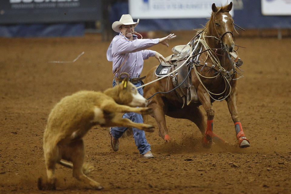 Photo - Jess Tierney of Hermosa, South Dakota,  competes in the tie-down roping event during the Timed Event Championship inside the Lazy E Arena in Guthrie, Okla., Friday, March 13, 2020. [Bryan Terry/The Oklahoman]